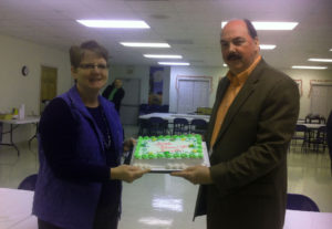 Suzette Knox being honored with a cake